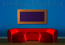 Red couch with empry frame Stock Photography
