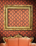 Red couch with empty frame Royalty Free Stock Image