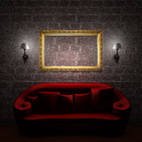 Red couch with empty frame and sconces Royalty Free Stock Photo
