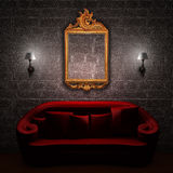 Red couch with empty frame and sconces Stock Photos