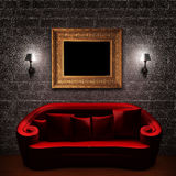 Red couch with empty frame and sconces Royalty Free Stock Photos
