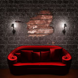 Red couch with empty frame and sconces Royalty Free Stock Image