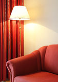 Red couch and lamp Royalty Free Stock Images