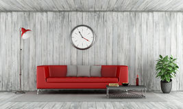 Red couch in old wooden room Stock Image