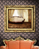 Red couch with picture frame stock photography
