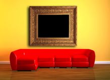 Red couch with picture frame Stock Image