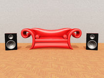 Red Couch and Speaker Boxes Stock Images
