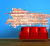Red couch with splash hole Stock Photo