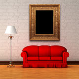 Red couch with standard lamp and picture frame Royalty Free Stock Image