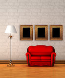 Red couch with standard lamp and picture frames Stock Photos