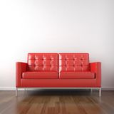 Red couch in white room Stock Photo