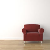 Red couch on white wall Royalty Free Stock Photography