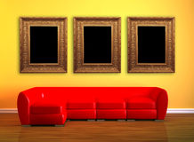 Red Couch With Three Picture Frames Stock Images