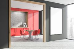 Red countertops kitchen corner with poster royalty free stock photo