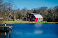 Red country barn by the pond Royalty Free Stock Photo