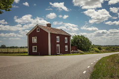 Red countryside cottage. Countryside cottage in rural Sweden Stock Photography