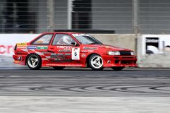 Red coupe drifting at Formula Drift Championship Royalty Free Stock Photography