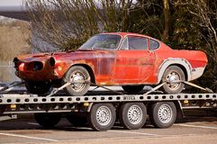 Red Coupe on Flatbed Trailer Stock Photos