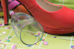 Red court shoe ang glass of champagne Royalty Free Stock Photos