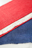 Red Cover Book And Fabric On Table In Factory Royalty Free Stock Photos