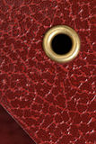 Red cover with golden rivet. Royalty Free Stock Photography