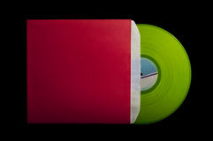 Red cover with green vinyl. Isolated on black bacground Stock Photography