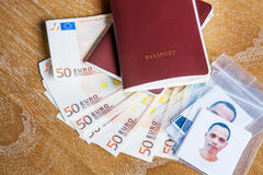 Red cover passport book ,face of asian man with fifty euro bank Stock Images