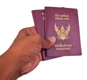 Red cover passport of thailand in hand Stock Photos