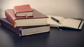 Red Covered Book Beside Black Click Pen Royalty Free Stock Images