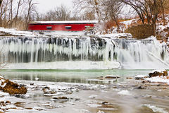 Red Covered Bridge and Frozen Waterfall Royalty Free Stock Image