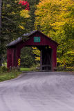 Red Covered Bridge and Gravel Road - Autumn / Fall - Vermont Royalty Free Stock Photography