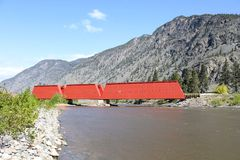 Red Covered Bridge, Keremeos, British Columbia. A red, covered bridge which crosses the Similkameen River near Keremeos. Originally a rail bridge built in 1907 Royalty Free Stock Photos