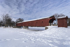 Red Covered Bridge Over the Grand. The West Montrose Bridge aka Kissing Bridge on a winters day Royalty Free Stock Images