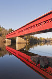 Red Covered Bridge with Reflection in Water stock photography