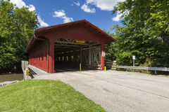 Red Covered Bridge. A red covered bridge spanning a river Royalty Free Stock Photo