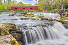 Red Covered Bridge and Whitewater Stock Photo