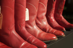 Red cowboy boots in a row Royalty Free Stock Photo