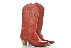 Red cowboy boots on white Stock Images