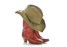 Red cowgirl boots and hat isolated. On white royalty free stock photography