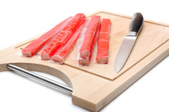 Red crab stick on wooden board Stock Photo