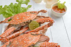 Red crabs on a plate, Boiled crabs with lime Stock Photos