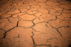 Red cracked ground. Deep cracks Royalty Free Stock Images
