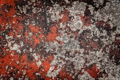Red cracked paint on old concrete. Old red cracked paint on concrete background royalty free stock photography