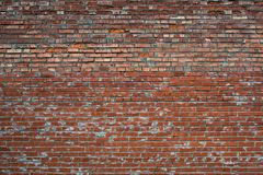 Red Cracked white grunge brick wall textured Royalty Free Stock Image