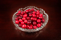 Red cranberry in crystal plate Royalty Free Stock Images