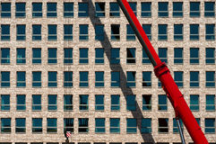 Red crane. Against new building Stock Image