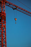 Red Crane. A red crane and a blue sky Royalty Free Stock Image