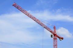 Red crane against blue sky Stock Photo