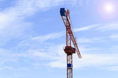 Red crane on blue sky Stock Images