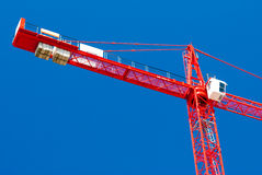 Red crane. A red crane with blue sky background Stock Photos